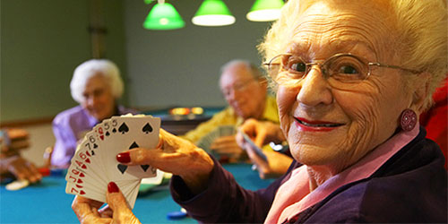 senior woman playing cards